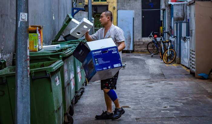 man throwing out trash