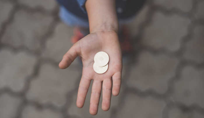 person holding change in hand