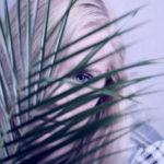 female looking through plant