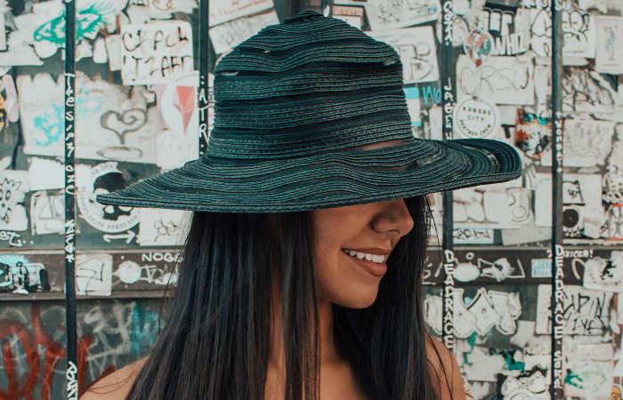 woman behind hat