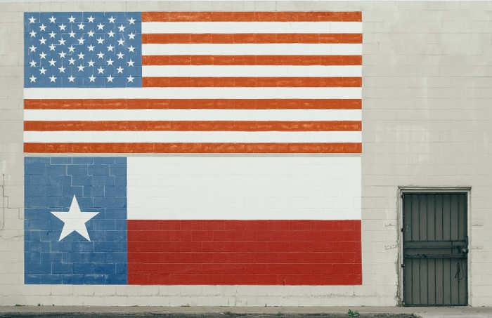 texas and usa flag on wall