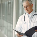 doctor looking at file