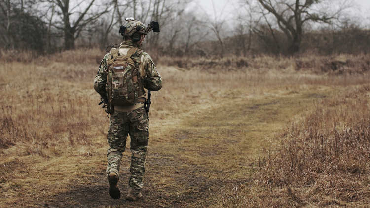 man walking with military gear on