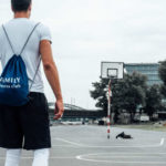 man with basketball approaching court