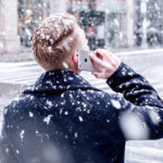 man talking on cell phone in snow