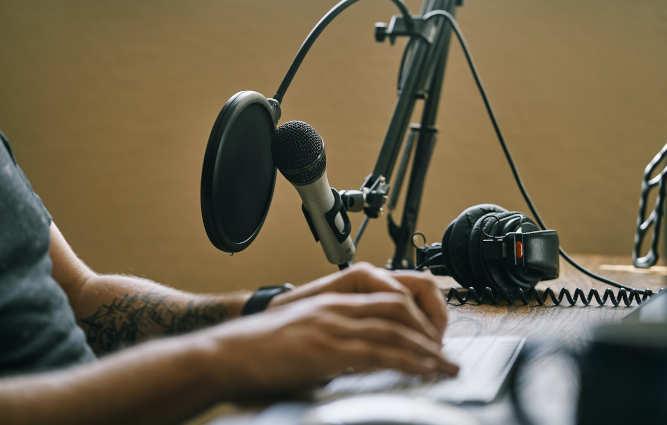 man sitting next to microphone